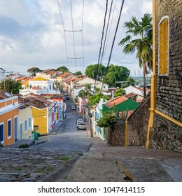 OLINDA, BRAZIL - MARCH 15, 2018: the historic architecture of Olinda in Pernambuco, Brazil showcasing its 17th century colorful buildings and endless cobblestone streets along the hill.