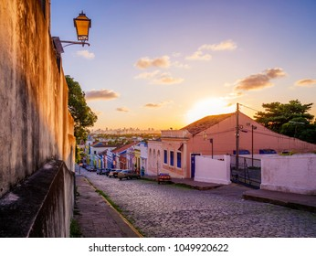 OLINDA, BRAZIL - MARCH 19, 2018: Panoramic view of the historic architecture of Olinda in Pernambuco, Brazil with its cobblestone streets and 17th century buildings at sunset.