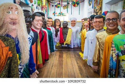 OLINDA, BRAZIL - MARCH 20, 2018: Brazilian Carnival Masks and decoration used in Olinda, PE, Brazil during the local Carnival festival made of wood, paper, and fabric and painted with vibrant colors.