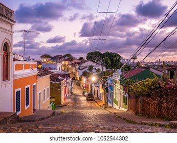 OLINDA, BRAZIL - MARCH 22, 2018: the historic city of Olinda in Pernambuco, Brazil at sunset showcasing its cobblestone streets and 17th century buildings at Ladeira da Misericordia street.