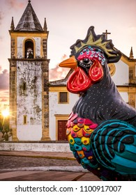 OLINDA, BRAZIL - MARCH 23, 2018: The colonial architecture of Olinda in Pernambuco, Brazil showcasing its Baroque style churches, cobblestone streets, and carnival decoration at sunrise.