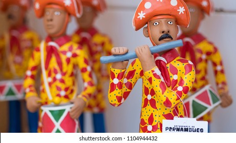 OLINDA, BRAZIL - MARCH 23, 2018: Little clay sculptures painted with vibrant colors commonly used as home decor in the city of Olinda and Recife in Pernambuco, Brazil.