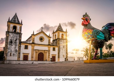 OLINDA, BRAZIL - MARCH 25, 2018: The colonial architecture of Olinda in the state of Pernambuco, Brazil at sunrise with some carnival decor still standing by the Se Church.