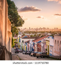 OLINDA, BRAZIL - MARCH 25, 2018: The historic architecture of Olinda in Pernambuco, Brazil at sunset with its colonial buildings dated from the 17th century and cobblestone streets.