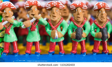 OLINDA, BRAZIL - MARCH 25, 2018: Little clay sculpture painted with vibrant colors representing a Pifanos Band performing Forro songs used as home decoration in the Northeast of Brazil.