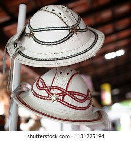 OLINDA, BRAZIL - MARCH 25, 2018: Typical Brazilian leather hat from the Northeast of the country painted in white and red.