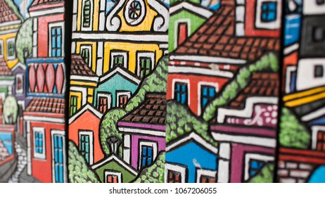 OLINDA, BRAZIL - MARCH 26, 2018: Carved wood representing a colonial city painted with vibrant colors used as home decor in thew cities of Olinda and Recife in the state of Pernambuco, Brazil.