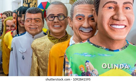 OLINDA, BRAZIL - MARCH 30, 2018: Brazilian Carnival masks used in Olinda, PE, Brazil during the local Carnival festival made of wood, fabric, and paper and painted with vibrant colors.