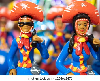 OLINDA, PE, BRAZIL - MARCH 25, 2018: Brazilian art and craft made in Olinda, PE, Brazil from clay and painted with vibrant colors called Boneco de Barro used as home decor.