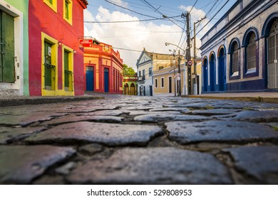 OLINDA, PE. BRAZIL - NOVEMBER 20: The historic streets of Olinda in Pernambuco, Brazil with its cobblestones and buildings dated from the 17th century at Quatro Cantos crossing on November 20, 2016.