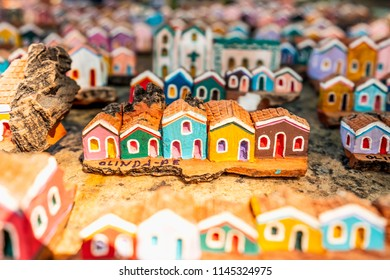 Olinda, Pernambuco, Brazil - JUL, 2018: Close up of Little wooden carvings representing the colorful houses and architecture of Olinda