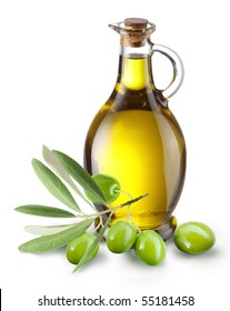 Olive branch and olive oil bottle isolated on white.