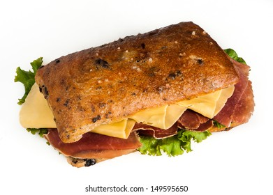 Olive bread sandwich, with prosciutto, cheese and vegetables on white