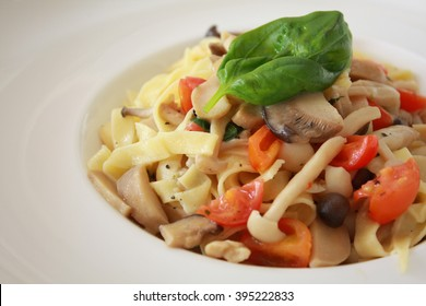 Olive drenched Fettuccine with mushroom and tomatos
