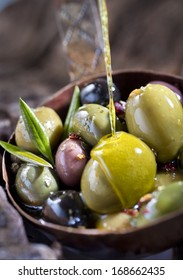 Olive fruit and leaves soaked in olive oil.