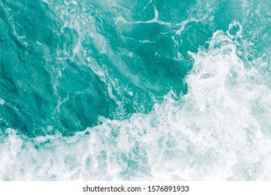 Olive green ocean wave during summer tide, abstract sea nature background