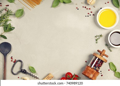 Olive oil, balsamic vinegar, salt, pepper, herbs, pasta, tomatoes on concrete background - cooking ingredients background -- top view - space for text. Healthy food, vegetarian , italian food concept.