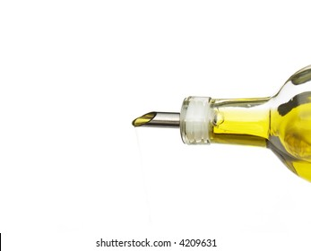 olive oil being poured from a glass bottle