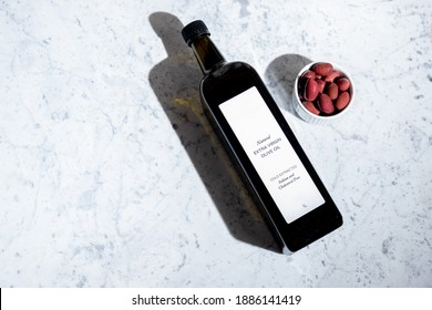 olive oil bottle with blank label on marble background