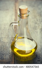 Olive oil bottle on wood table