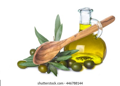 Olive oil bottle and wooden spoon with leaves and olives isolated on a white background