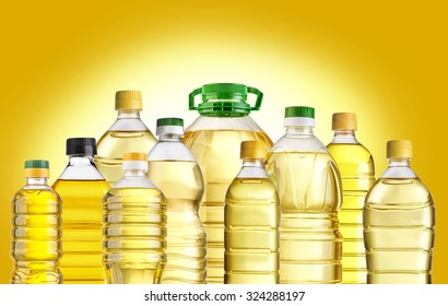Olive oil bottles isolated  on yellow  background
