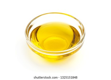 Olive oil in bowl, close-up, isolated on white background.