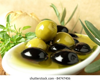 Olive oil bowl, Olives in oil and herbs, Extra virgin olive oil, Health mediterranean diet olive oil, Health food,