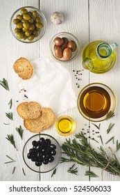 Olive oil with  bread and olives mix on the white wooden table top view