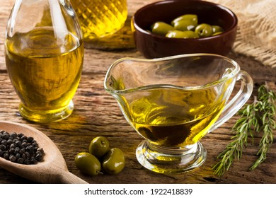 Olive oil. Containers with virgin olive oil and olives. - Shutterstock ID 1922418839