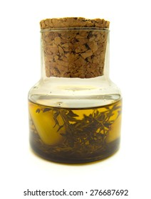 olive oil flavoured with thyme and garlic, small jar isolated on white