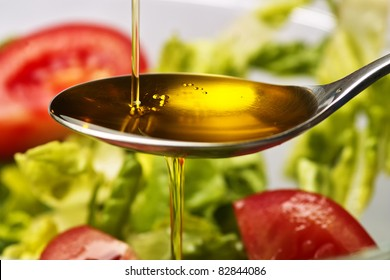 olive oil floes into a spoon