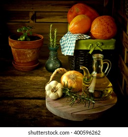 Olive oil and food ingredients in rustic kitchen
