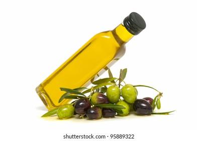 olive oil and fresh olives on white background