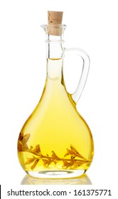 Olive oil in glass jug isolated on white background