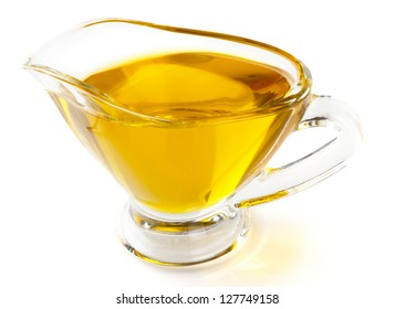 Olive oil in gravy boat, isolated  on white background