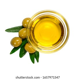 Olive oil. Greek olive oil in glass transparent bowl with leaves and marinated olives. Close up, isolated on white background.