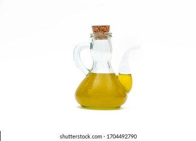 Olive oil in old oil can on white background