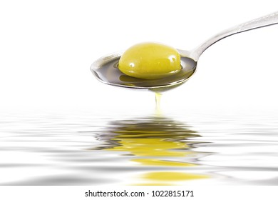olive oil on spoon on white background