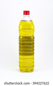 Olive oil in a plastic bottle, isolated in a white background