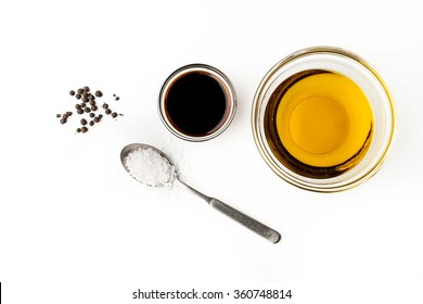 Olive oil with seasoning on the white background top view