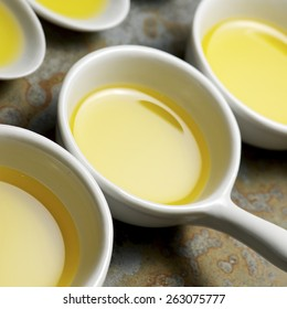 Olive oil in a small china spoons.