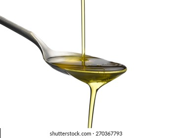 olive oil and spoon isolated on a white background