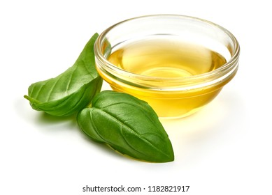 Olive or vegetable oil with basil leaves, isolated on white background