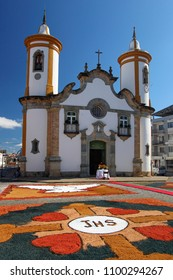 OLIVEIRA, MG / BRAZIL - 2015-06-04: Colorful carpets adorn the front of the baroque church for the celebration of Corpus Christ in Minas Gerais.