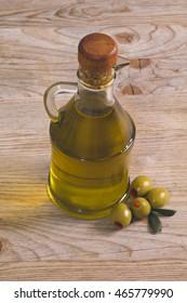 olives and bottle of extra virgin olive oil