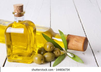 olives and bottle of oil, food backgrounds