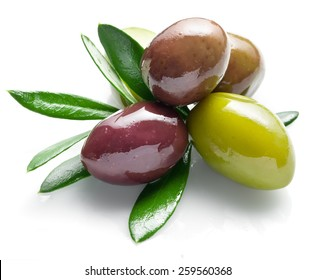 Olives with olive leaves isolated on a white background.
