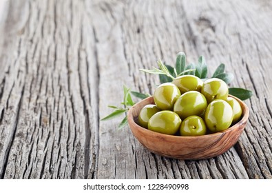 Olives on wooden background