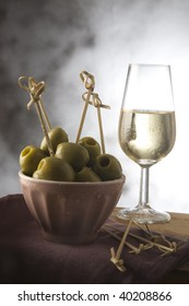 olives tapas and white wine